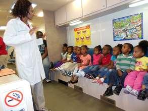 Children get a check-up in the Colgate dental van