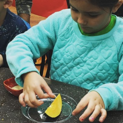 Coastal Bend Food Bank (Corpus) child tries squash