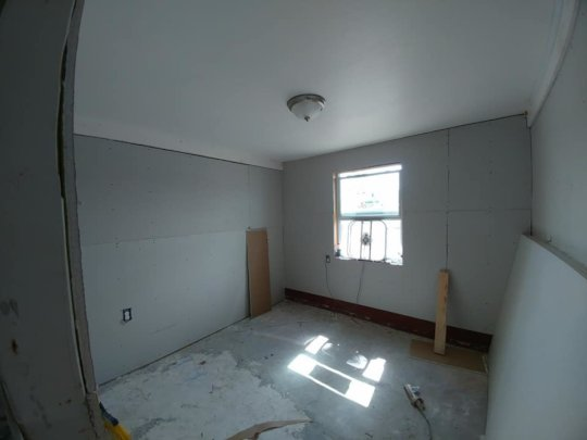 Peter's house with fresh drywall and insulation