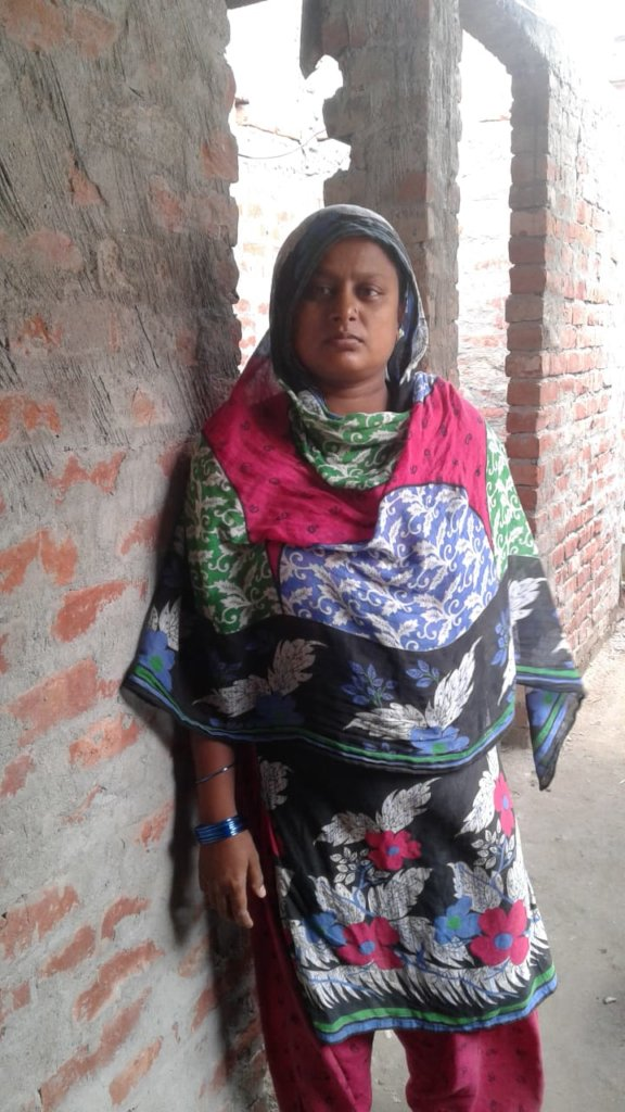 Dolly Khatoon in front of her home