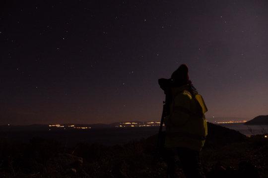 A volunteer on spotting shift at night (2019)