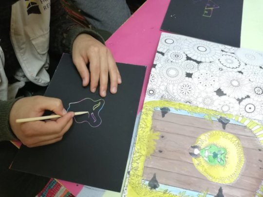 Drawing activities with Resident Volunteers