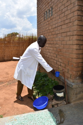 A Health officer getting water at Chiunjiza