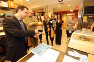 Dr Vassilopoulos giving donors a lab tour