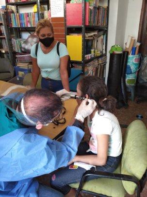 SAI medical Doctor examines orphan girl's ears.
