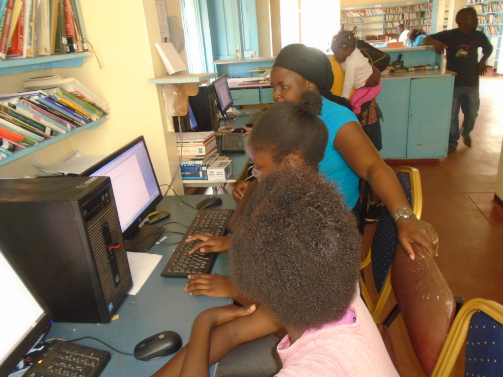 Young library users learning how to use computers