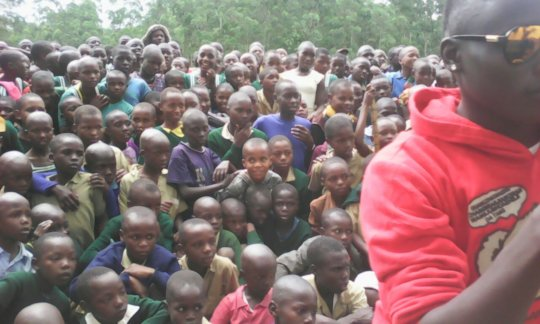 Crowd of pupils listening to anitFGM messaging