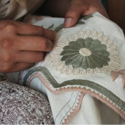 embroidering by hand in aguacatenango