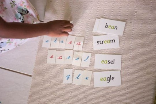 A 4 year old practices phone-grams