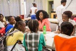 Cleo tutoring Barbudan children