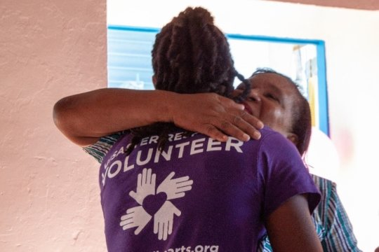 A community member thanking a volunteer