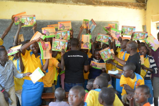 Children showing off books they had received
