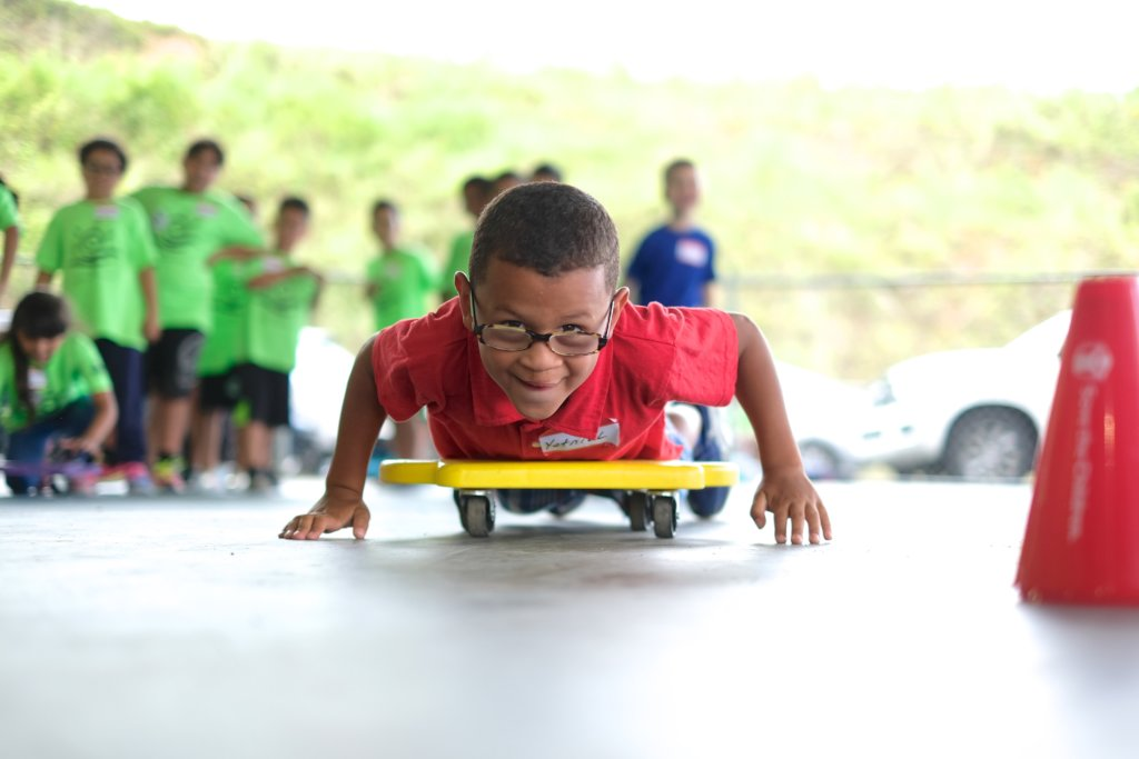A young boy races during a team building activity