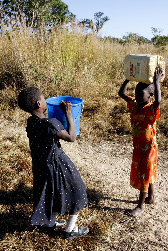 Saviour and Valencia fetching water