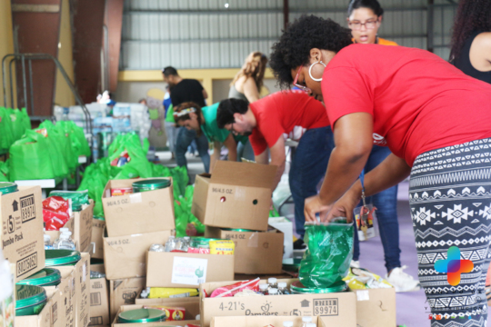 Volunteers organize food and supplies