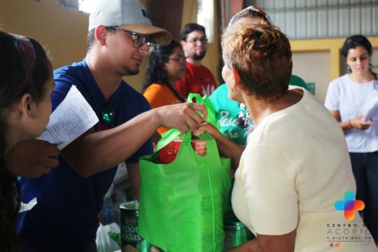 Volunteers dispatch food to community members