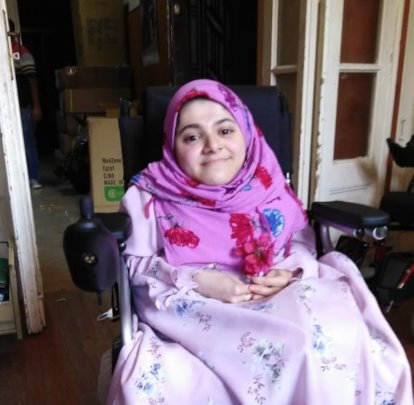 Noura on her Wheelchair