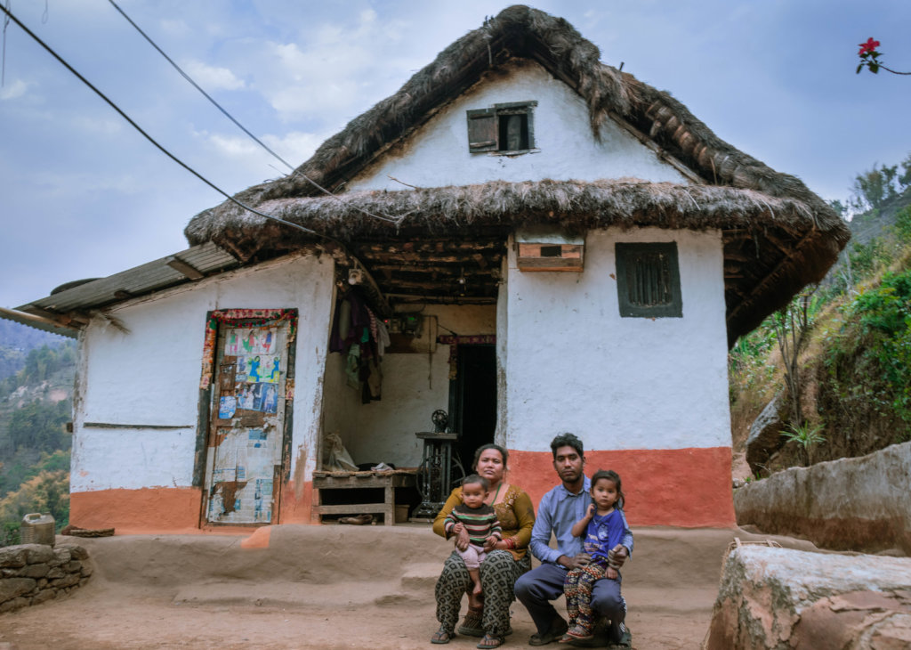 Sarita & her family in front of their family home