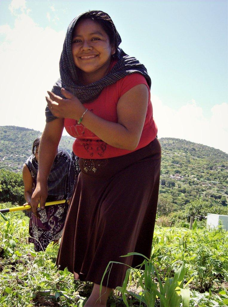 Reyna planting corn