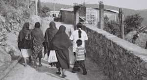Women walking to Atzin Centre