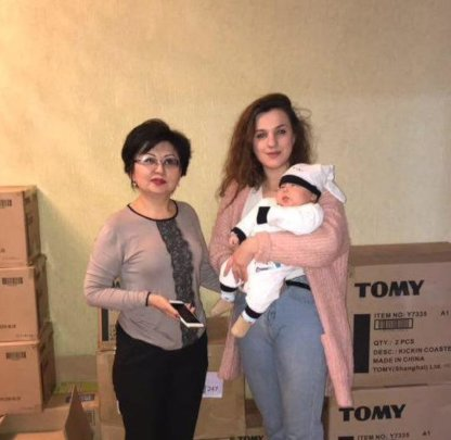 Ulianna presenting much needed supplies for kids