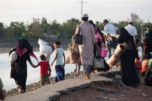 Rohingya families arrive in Cox's Bazar.