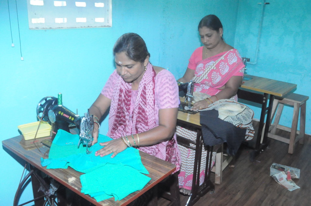 provide sewing machine to 6 poor women to earn