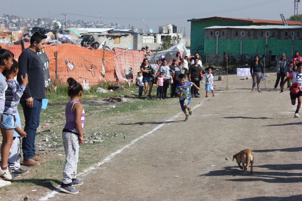 Luis, far left, volunteering at the Mini-Olympics