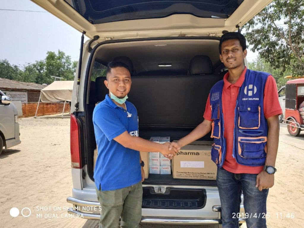 Representative from MSF gifting the donations