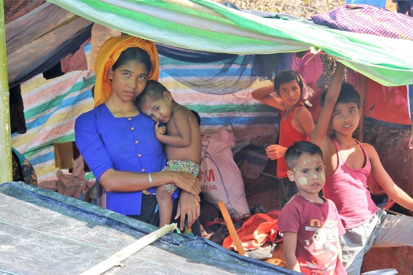 "A Rohingya family inside their ""home"""