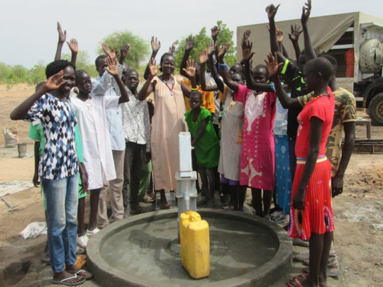 Happy Villagers at Newly Drilled Well