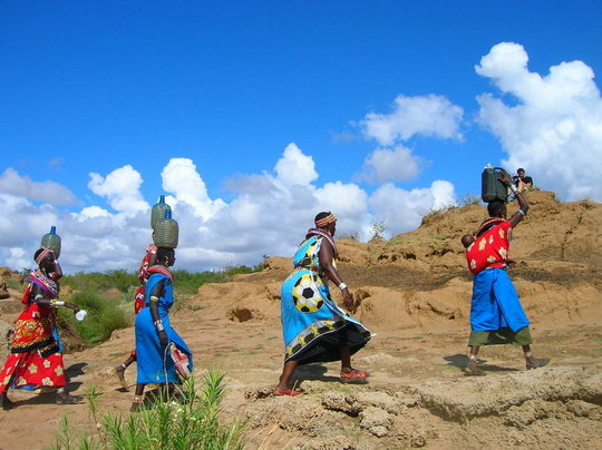 Women of Umoja Hauling Water