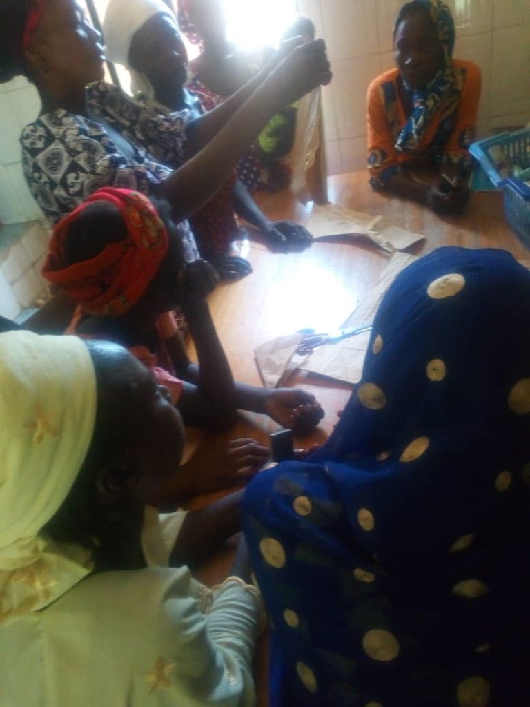 Recipients learning how to cut and design clothes