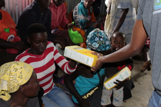 Community members receiving flour supplies