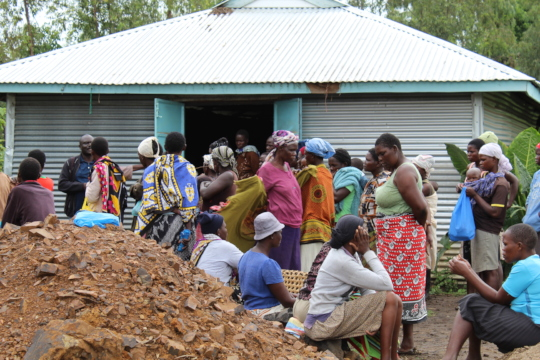 Members of the community outside the camps