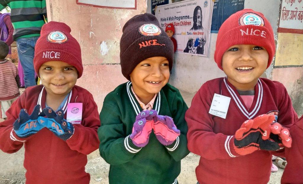 Happy Poor Kids with Warm Dress !!