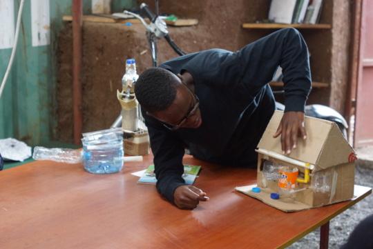 Frank showing his rainwater harvest sketch model