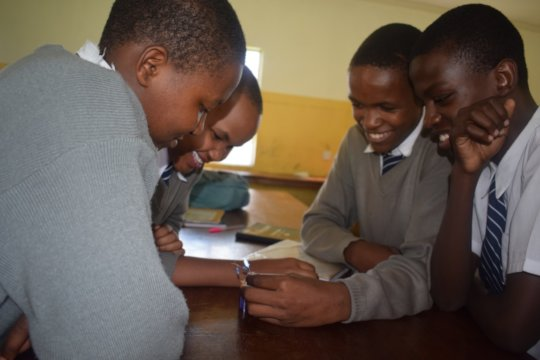 Students testing an LED Torch during an outreach