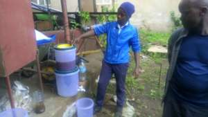 Form 4 student sharing his water filter prototype