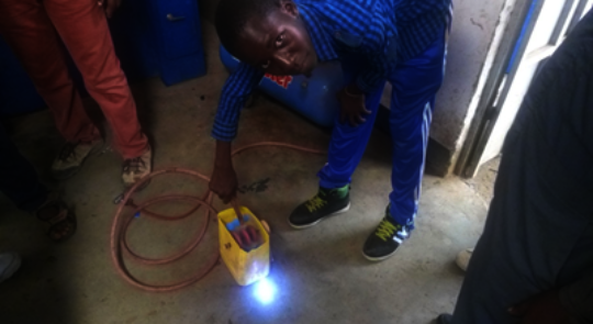 Felix working on his hydropower prototype