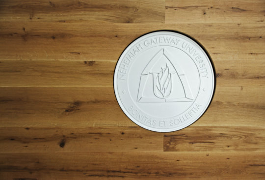 The seal of Nehemiah Gateway University
