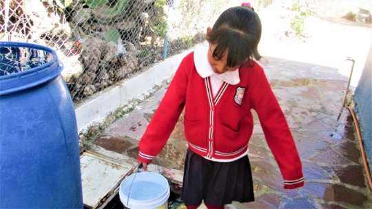 Carrying rainwater to filter in La Vaciada
