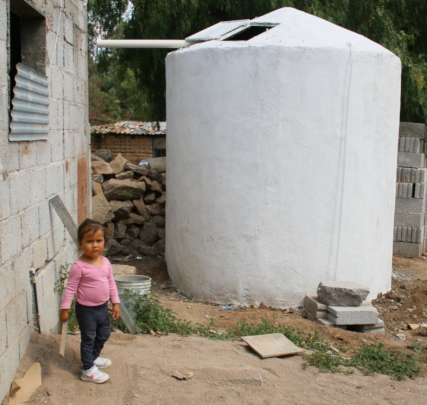 In front of her new cistern