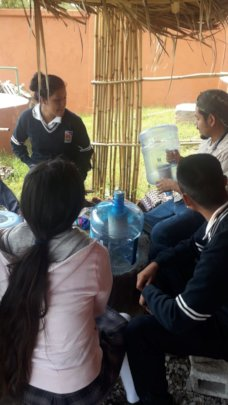 Caminos staff talk water filtration with students