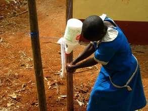 A Schoolchild Washes her Hand