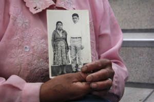 Relative with a photo of disappeared loved one