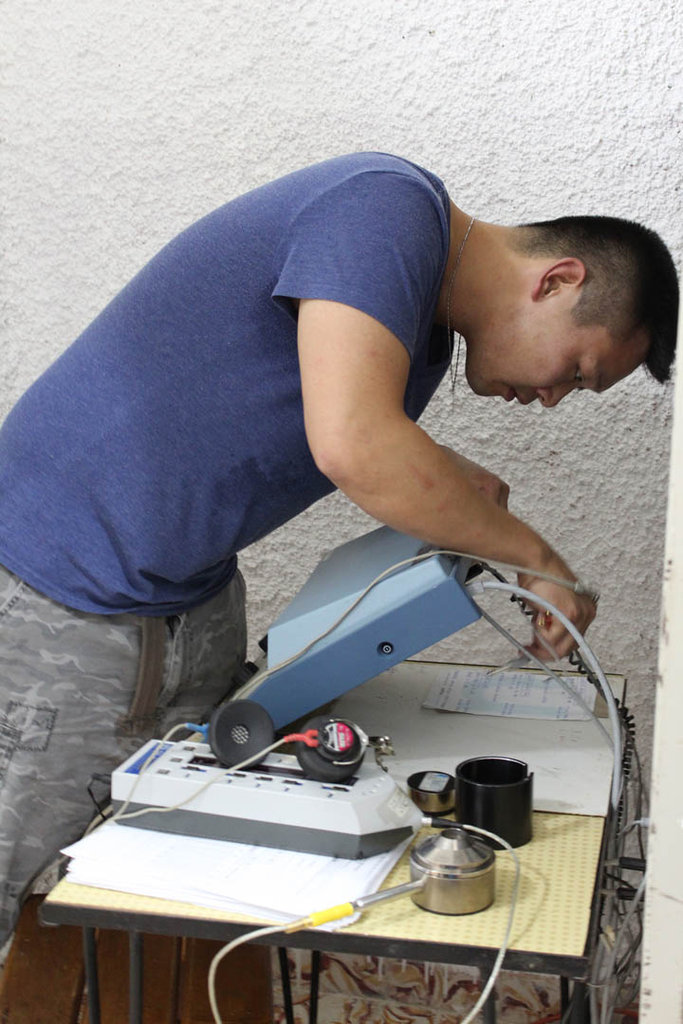 Technicians setting up equipment