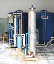 A similar water filtration system in use in Haiti
