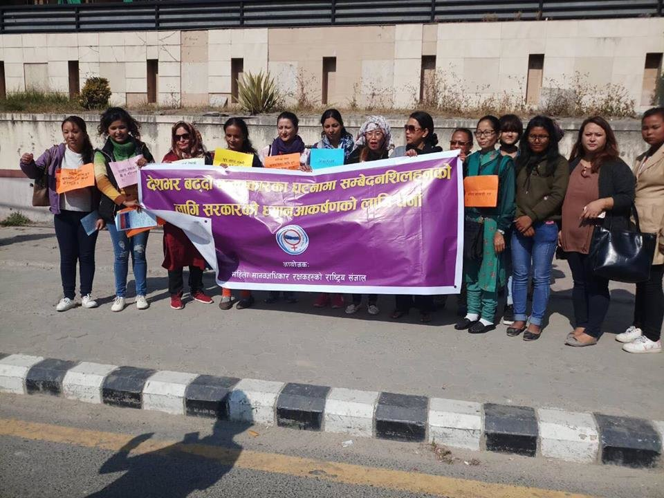 Nikiba (2nd from right) on protest rally on VAW