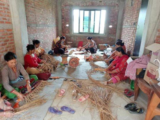 Community women making products out of plastic
